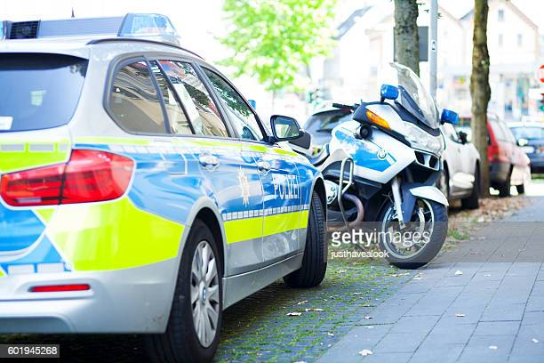 Parked german police car and motorcycle