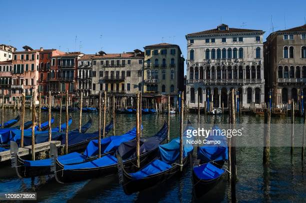 Parked gondolas are seen in Canal Grande . The Italian government imposed unprecedented restrictions to halt the spread of COVID-19 coronavirus...