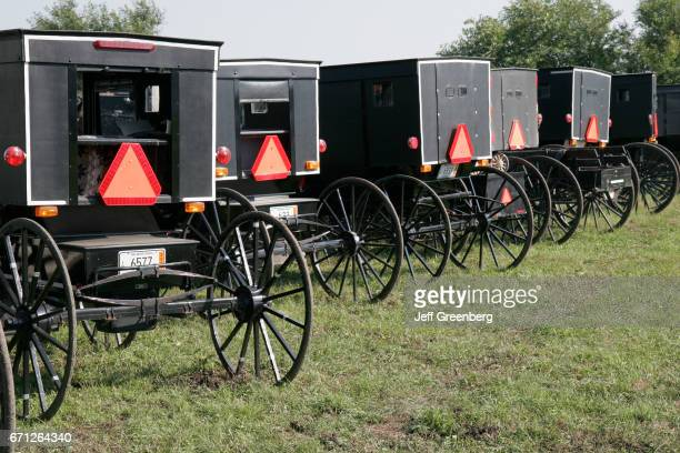 Parked horsedrawn Amish buggy at a farm auction in Shipshewana