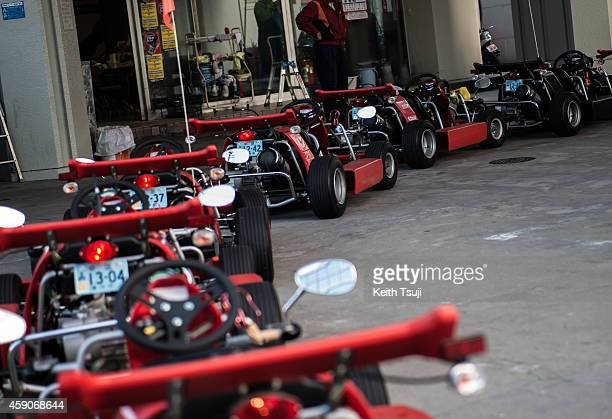 Parked karts are seen at the gas station for the Real Mario Kart event in Tokyo on November 16 2014 in Tokyo Japan The organizer calls for...