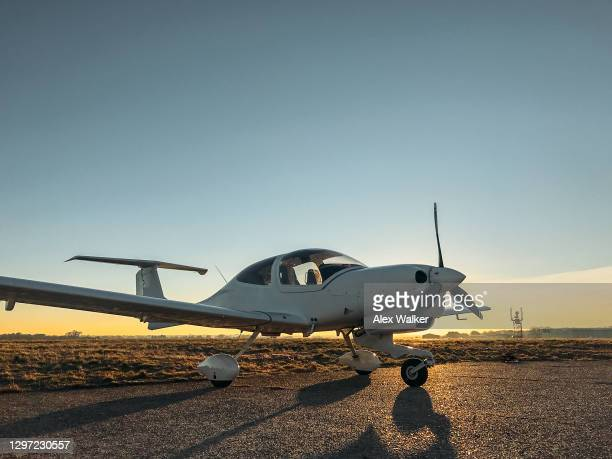 parked small single engine propeller aircraft at sunset - flying stock pictures, royalty-free photos & images