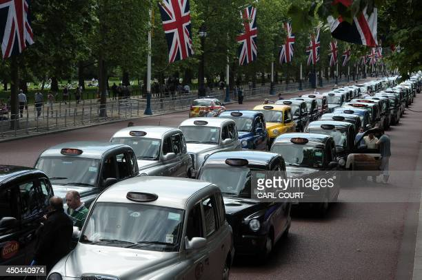 Parked taxis block the Mall leading to Buchingham Palace during a protest by London Black Cab drivers against a new private taxi service 'Uber' a...