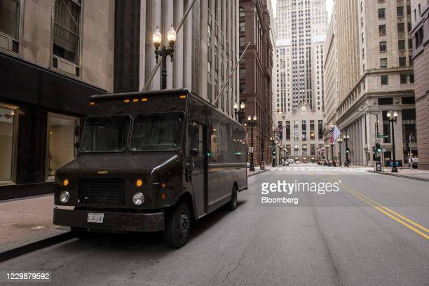 Parked United Parcel Service Inc. Truck in Chicago, Illinois, U.S., on Monday, Nov. 30, 2020. Online shoppers in the U.S. Are expected to drop a...