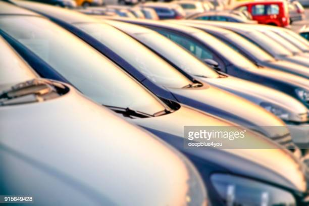 parked vehicles on a public dealership in hamburg, germany - car park stock pictures, royalty-free photos & images