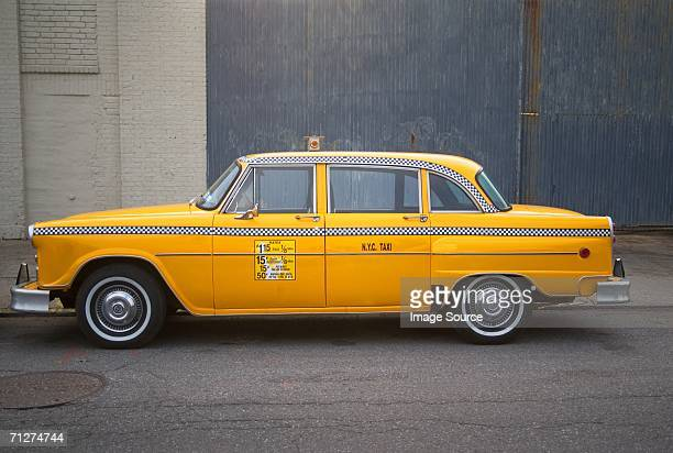 parked yellow taxi cab new york - taxi stock pictures, royalty-free photos & images