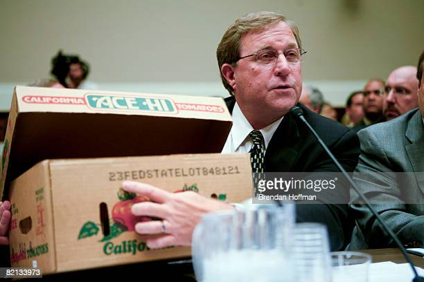 Parker Booth president of Ace Tomato Company displays a tracing code on a box of tomatoes during testimony on the recent Salmonella outbreak at a...