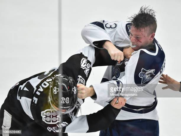 Parker Bowman of the Rimouski Oceanic fights against Joel Teasdale of the BlainvilleBoisbriand Armada during the QMJHL game at Centre d'Excellence...