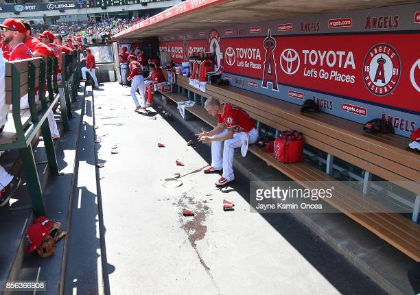 Parker Bridwell of the Los Angeles Angels of Anaheim sits in the dugout after pitching the second inning of the game against the Seattle Mariners at...