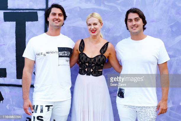 Parker Calvert Polina Proshkina and Clayton Calvert attend Tabula Rasa The 26th annual Watermill Center Benefit Auction at The Watermill Center on...