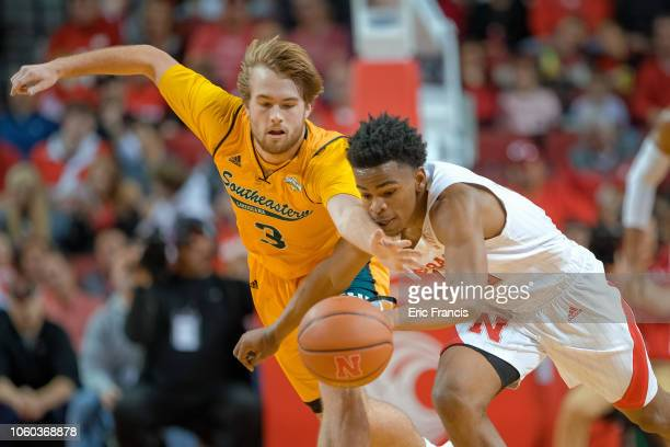 Parker Edwards of the Southeastern Louisiana Lions and Thomas Allen of the Nebraska Cornhuskers fight for a rebound during their game at Pinnacle...