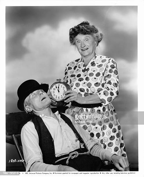 Parker Fennelly sleeps as Marjorie Main holds an alarm clock to his head in a scene from the film 'The Kettles On Old MacDonald's Farm' 1957