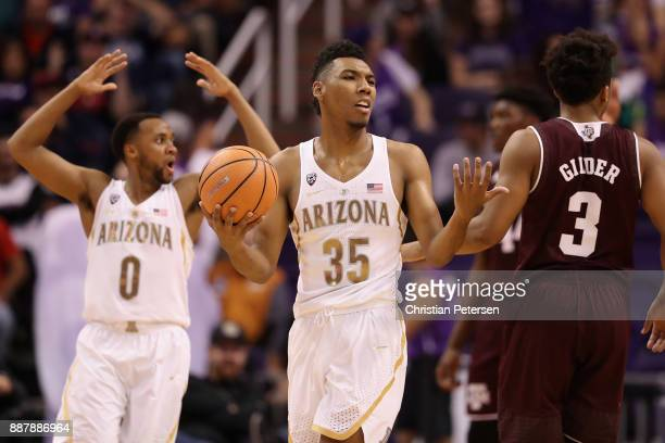 Parker JacksonCartwright and Allonzo Trier of the Arizona Wildcats react during the second half of the college basketball game against the Texas AM...