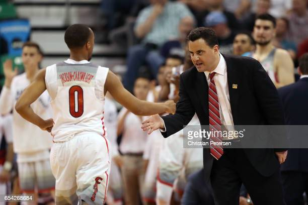 Parker JacksonCartwright highfives Head coach Sean Miller of the Arizona Wildcats against the North Dakota Fighting Sioux during the first round of...