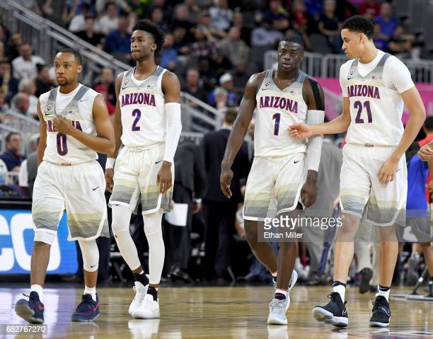 Parker Jackson-Cartwright, Kobi Simmons, Rawle Alkins and Chance Comanche of the Arizona Wildcats walk on the court during a semifinal game of the...