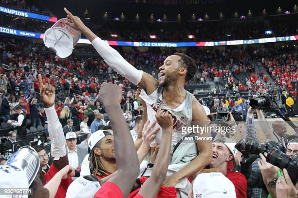 Parker JacksonCartwright of the Arizona Wildcats celebrates with his team during the championship game of the Pac12 basketball tournament at TMobile...