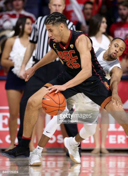 Parker JacksonCartwright of the Arizona Wildcats defends Bennie Boatwright of the USC Trojans during the second half of the college basketball game...
