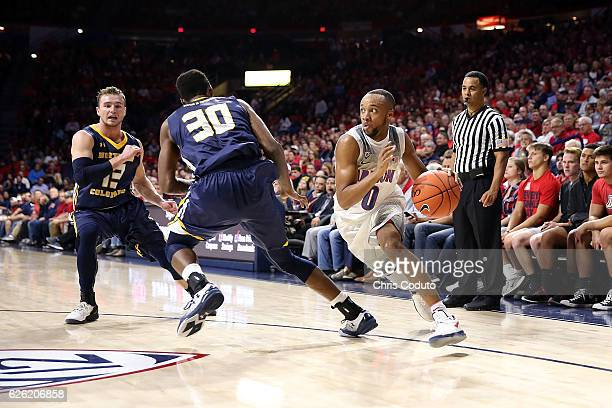 Parker JacksonCartwright of the Arizona Wildcats dribbles around Jon'te Dotson of the Northern Colorado Bears during the first half of the NCAA...