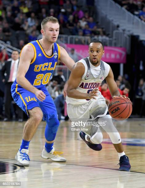 Parker JacksonCartwright of the Arizona Wildcats drives against Bryce Alford of the UCLA Bruins during a semifinal game of the Pac12 Basketball...