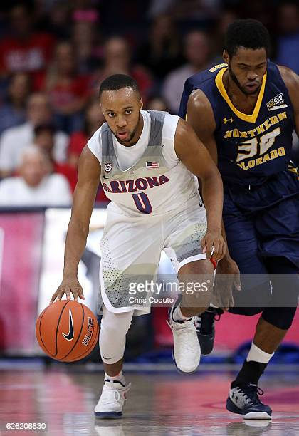 Parker JacksonCartwright of the Arizona Wildcats is defended by Jon'te Dotson of the Northern Colorado Bears during the first half of the NCAA...