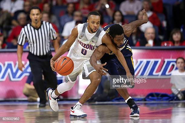 Parker JacksonCartwright of the Arizona Wildcats keeps the ball away from Jon'te Dotson of the Northern Colorado Bears during the first half of the...