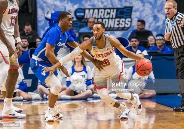 Parker JacksonCartwright of the Arizona Wildcats moves around G Davonta Jordan of the Buffalo Bulls during the NCAA Division I Men's Championship...