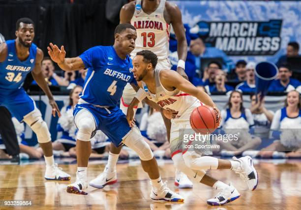 Parker JacksonCartwright of the Arizona Wildcats moves through G Davonta Jordan of the Buffalo Bulls during the NCAA Division I Men's Championship...
