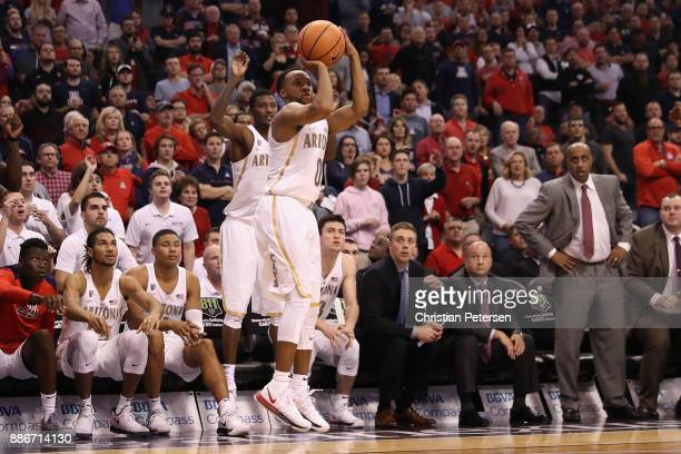 Parker JacksonCartwright of the Arizona Wildcats puts up a three point shot against the Texas AM Aggies during the second half of the college...