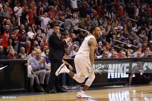 Parker JacksonCartwright of the Arizona Wildcats reacts after hitting a three point shot against the Texas AM Aggies during the second half of the...