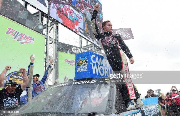 Parker Kligerman driver of the Food Country USA/Lopez Wealth Mgmt Toyota celebrates in Victory Lane after winning the NASCAR Camping World Truck...
