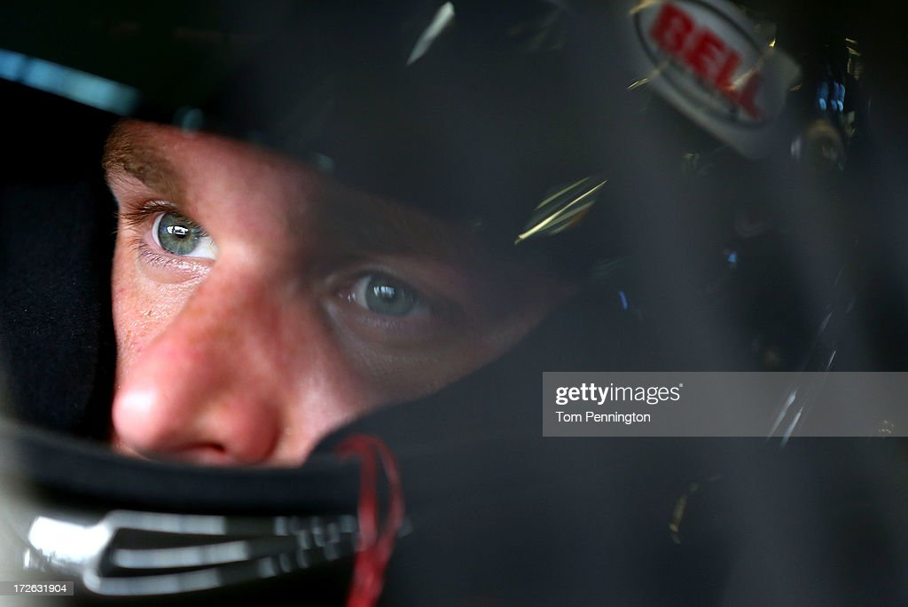 Parker Klingerman, driver of the #77 BanditChippers.com Toyota, looks on from his car during practice for the NASCAR Nationwide Series Subway Firecracker 250 at Daytona International Speedway on July 4, 2013 in Daytona Beach, Florida.