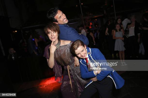 Parker Posey Zack Estrin Maxwell Jenkins attend Netflix's 'Lost In Space' Los Angeles premiere on April 9 2018 in Los Angeles California