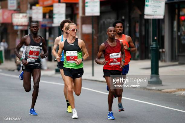 Parker Stinson of the United States and Panuel Mkungo of Kenya lead a group of eltie runners during the 2018 Rock 'n' Roll Philadelphia Half Marathon...