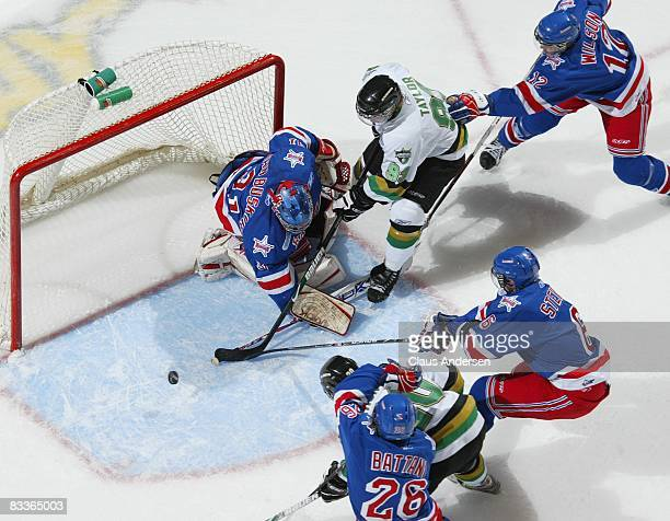 Parker Van Buskirk of the Kitchener Rangers stops a scoring attempt by Justin Taylor of the London Knights in a game against the London Knights on...