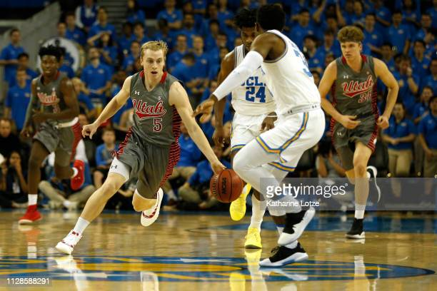 Parker Van Dyke of the Utah Utes drives down the court during a game against the UCLA Bruins at Pauley Pavilion on February 09 2019 in Los Angeles...