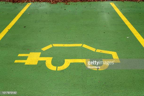 A parking bay marking displays an electric vehicle icon at a Supercharger station in Egerkingen Switzerland on Thursday Aug 16 2018 Tesla chief...
