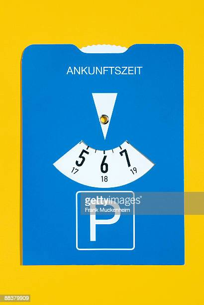 Parking meter on yellow background, close-up