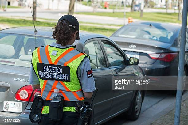 parking enforcement - parking meter stock photos and pictures