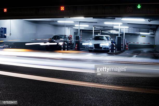 parking garage's exit - blurred motion - parking garage stock pictures, royalty-free photos & images