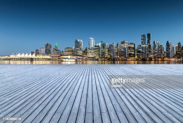 parking lot against vancouver city skyline - vancouver canada stock pictures, royalty-free photos & images