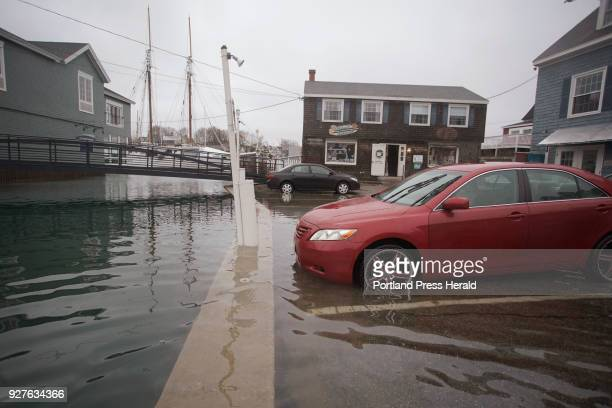 A parking lot along the Kennebunk River flooded during high tide on Friday March 2 2018 as a nor'easter slammed Maine with waves and high winds