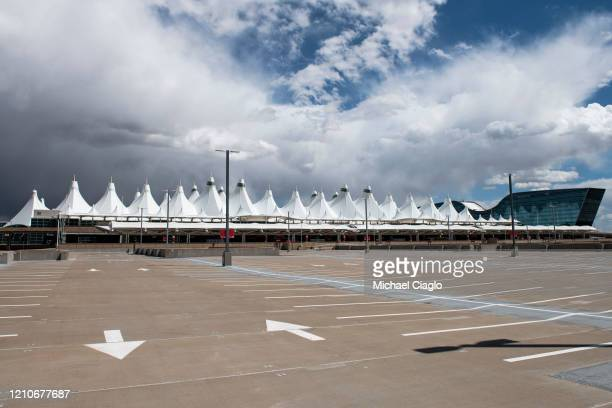 A parking lot at Denver International Airport sits empty as the coronavirus pandemic slows air travel on April 22 2020 in Denver Colorado Compared to...