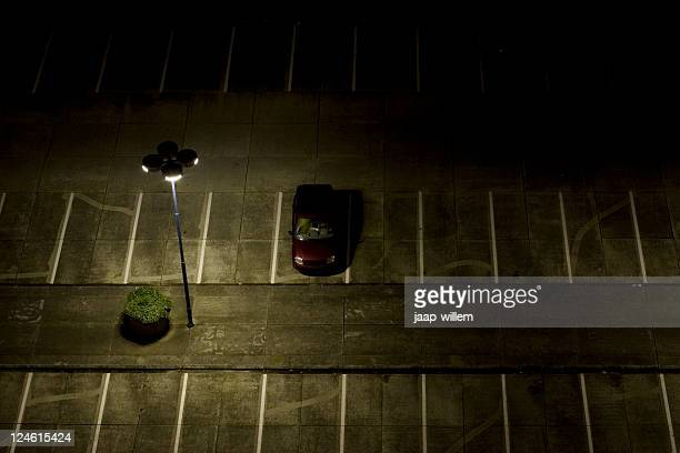 parking lot at night - car park stock pictures, royalty-free photos & images
