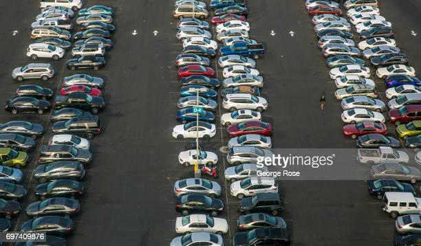 A parking lot filled with cars is viewed from the High Roller observation Ferris wheel on May 29 2017 in Las Vegas Nevada Tourism in America's 'Sin...