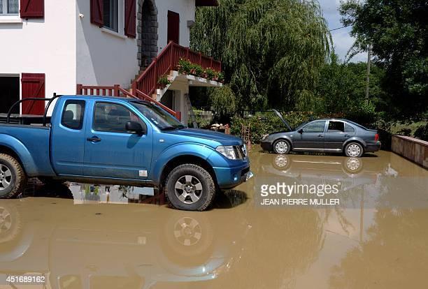 A parking lot is seen flooded in Saint Martin d'Arossa near SaintJeanPieddePort southern France on July 4 2014 following heavy rainfalls AFP PHOTO /...