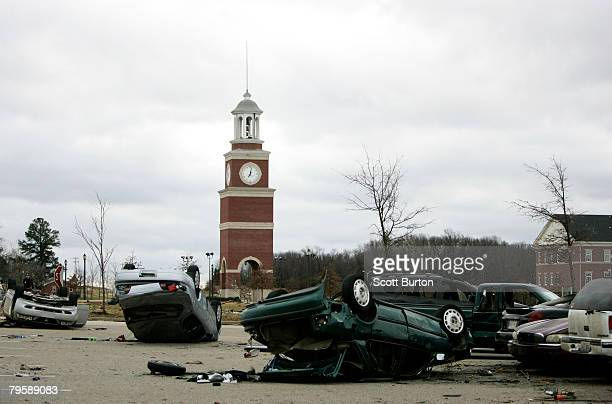 Parking lot is shown littered with cars destroyed when a tornado hit Union University February 6, 2008 in Jackson, Tennessee. A swarm of tornadoes...