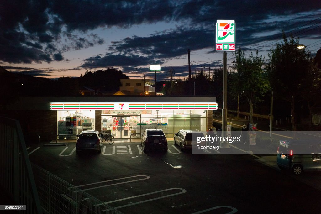 Parking lot of a 7-Eleven convenience store, operated by Seven & i Holdings Co., in Tokyo, Japan, on Saturday, Oct. 7, 2017. Seven & i is scheduled to report its second-quarter earnings results on Oct. 12. Photographer: Kentaro Takahashi/Bloomberg via Getty Images