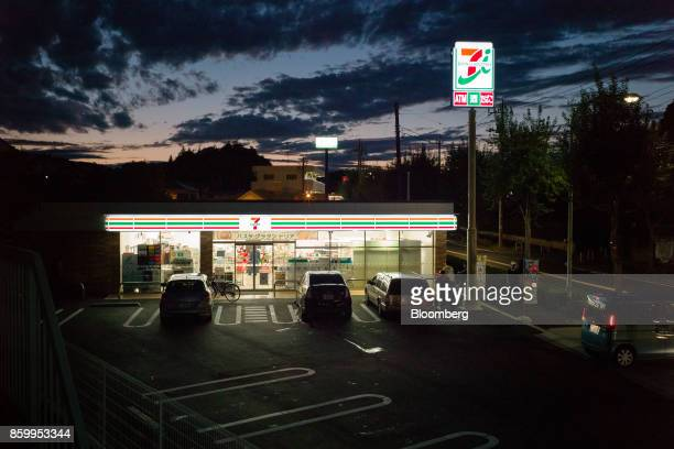 Parking lot of a 7Eleven convenience store operated by Seven i Holdings Co in Tokyo Japan on Saturday Oct 7 2017 Seven i is scheduled to report its...