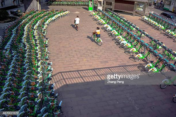 A parking lot of public bicycles where citizens can rent these public bikes by selfservice Beijing has invested in 40000 public bikes and 1000...