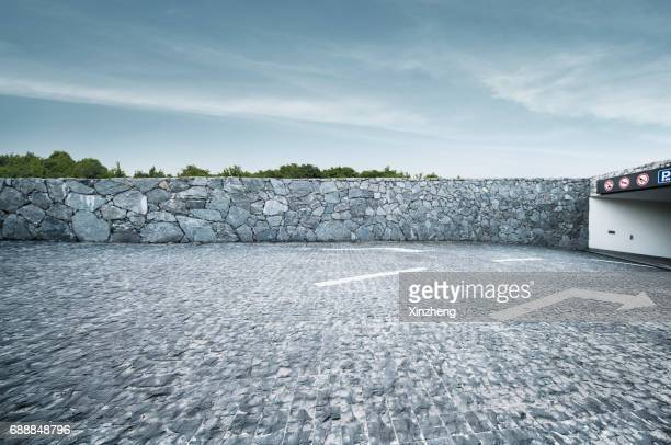 parking lot - stone wall bildbanksfoton och bilder