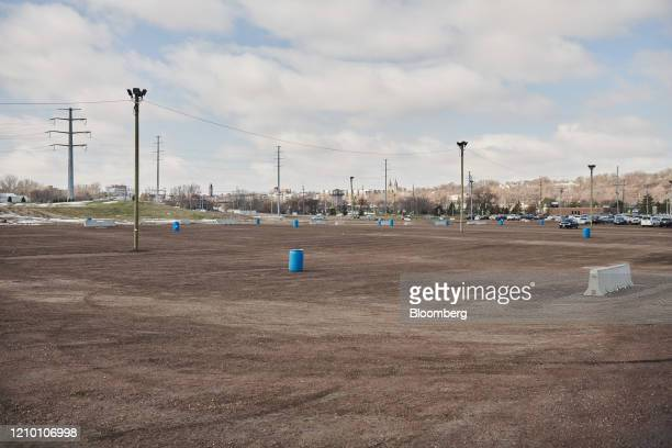 A parking lot stands empty outside a Smithfield Foods Inc plant closed in Sioux Falls South Dakota US on Wednesday April 15 2020 South Dakota...